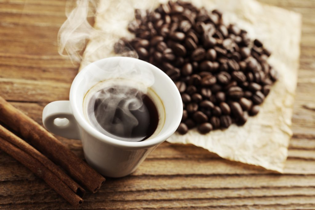 Smoking hot coffee with coffee beans