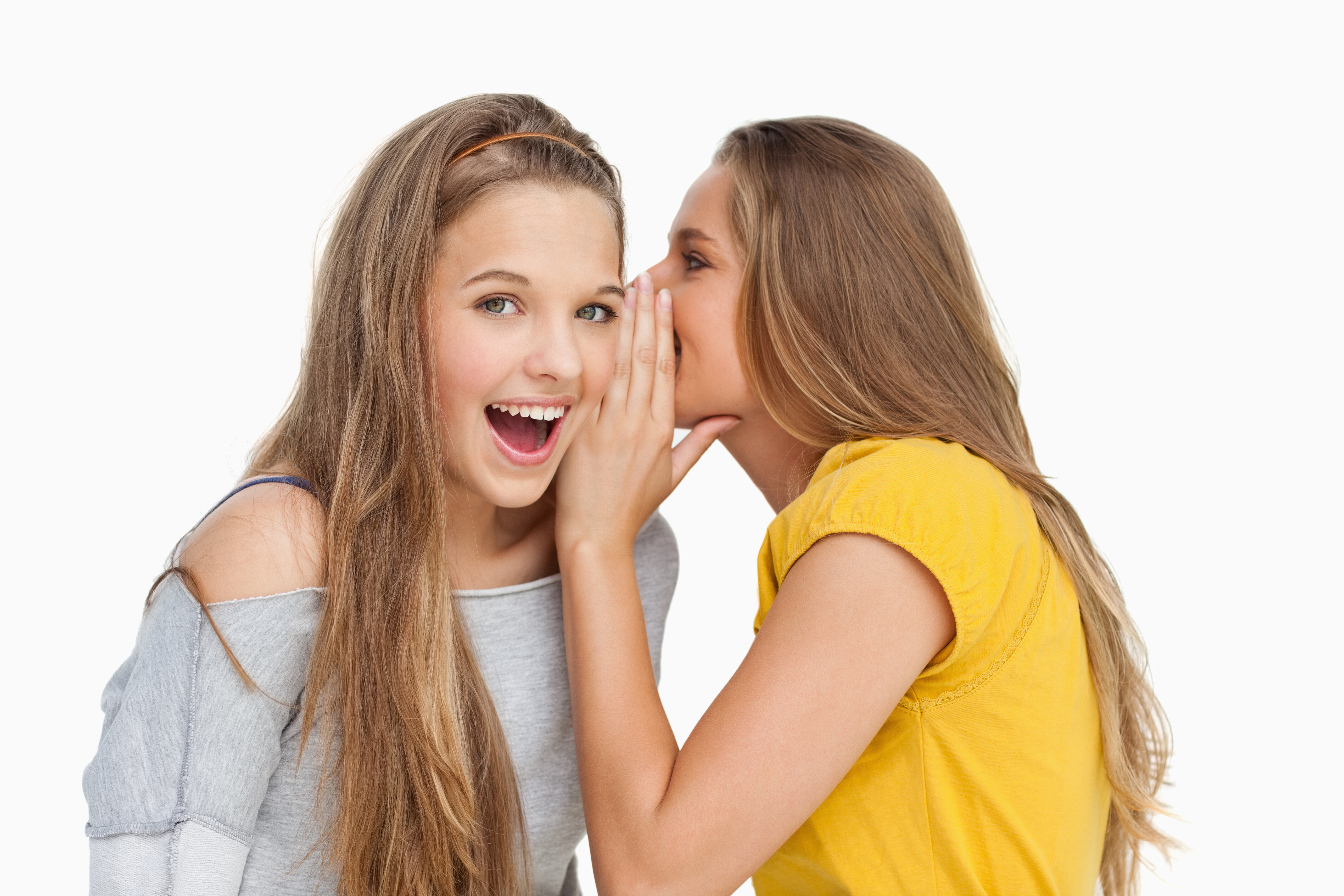 Blonde student whispering to her friend against white background