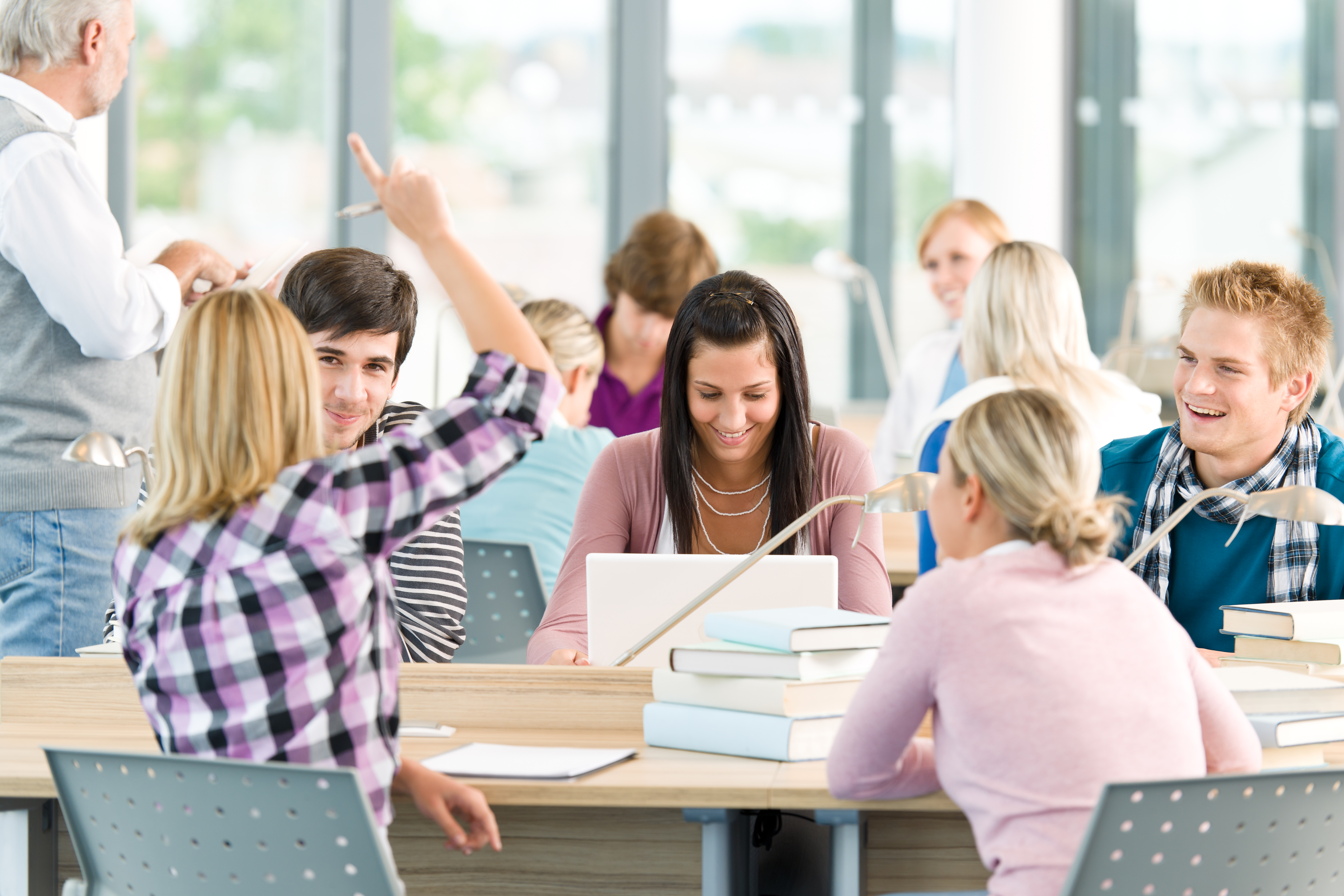 Group of students study in classroom at highschool with professor